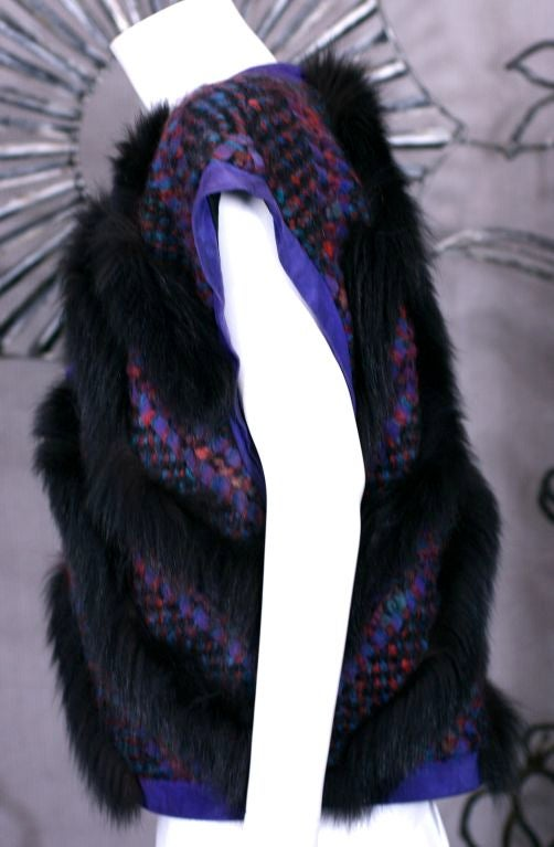 """Revillon square cut woven mohair, suede and fox gilet. Deep 12"""" slash armholes allow movement. Woven mohair in teal, black and wine  woven with purple suede strips. Completely edged in purple suede with chevron patterned black fox fur. Worn"""