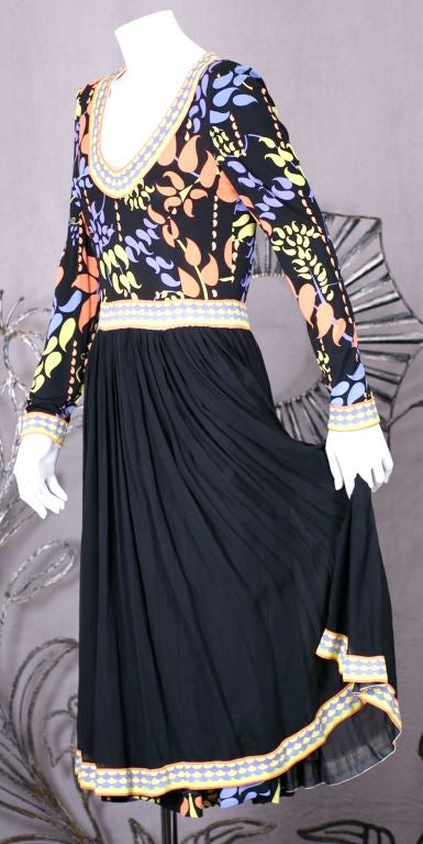 Silk jersey dress by Bessi, Italy. Bordered print bodice with full gathered black silk jersey skirt also bordered in print.<br /> Back zip entry, 1980s.
