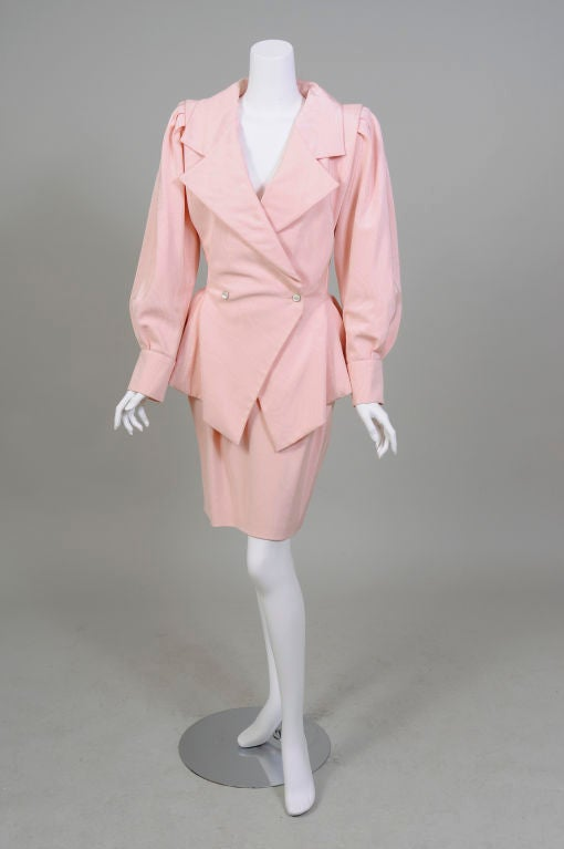 Pale pink silk moire belies the sexy attributes of this Haute Couture suit from the 1980's master of sexy dressing, Emanuel Ungaro.<br />