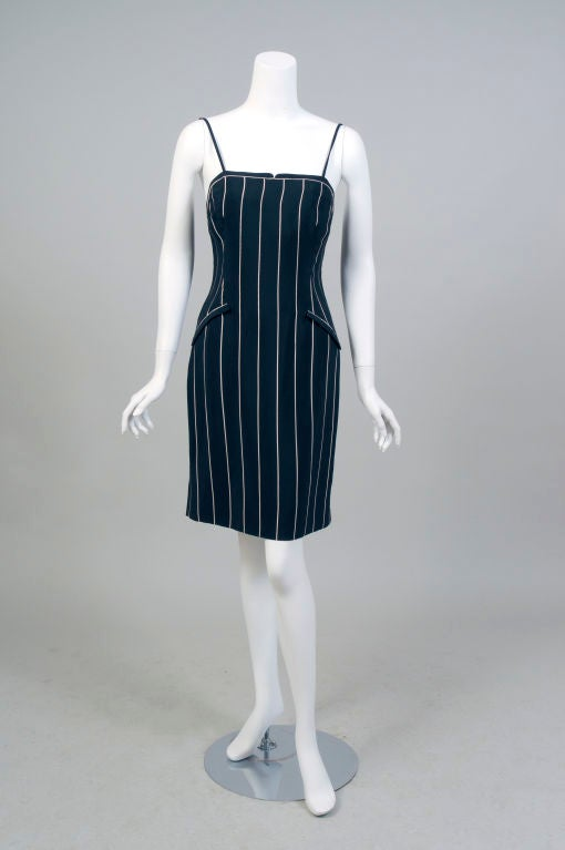 Geoffrey Beene does classic pin stripes on a sexy little dress with spaghetti straps, then he adds the bonus of a hip length jacket for the quintessential day into evening outfit.<br /> The menswear inspired fabric in a cream stripe on black silk