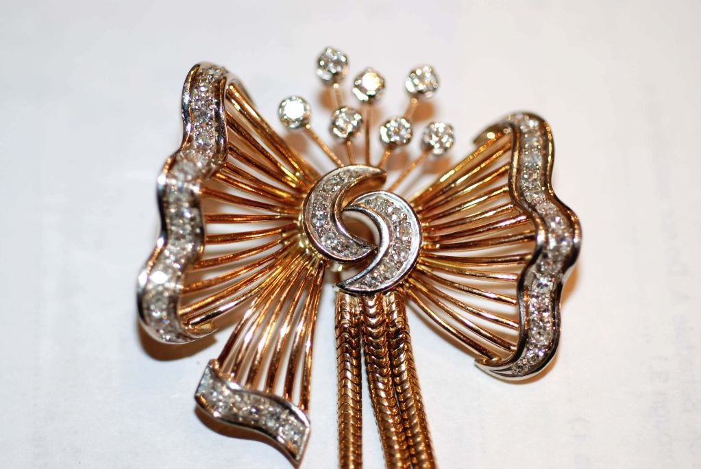 Beautiful Bow Pendant with Hanging Tassels. Contains 1.5 Carats diamonds-VS-SI clarity /G-H color.