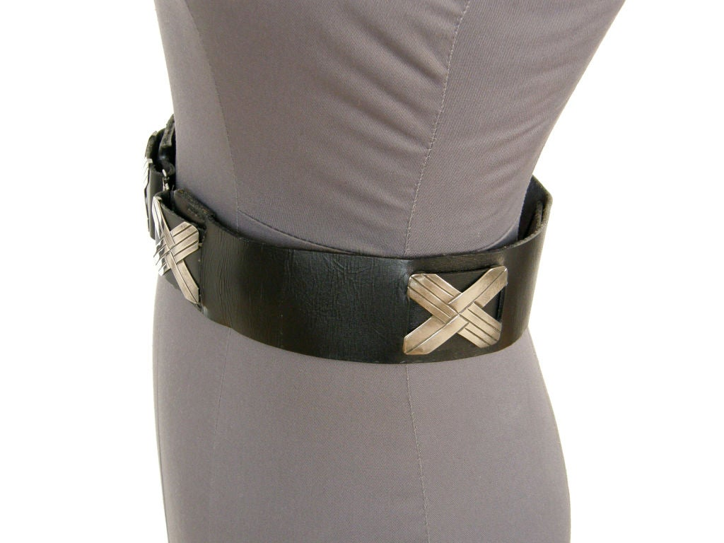 This c. 1930s or 1940s black leather belt is accented with five Mexican sterling
