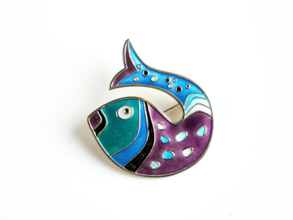 This enameled and gilt sterling fish brooch from David-Andersen has a 1950s modern style. The whimsical, abstracted fish is beautifully decorated with multi-colored enameling.  Please contact us if you have any questions.