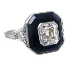An Art deco onyx and diamond ring