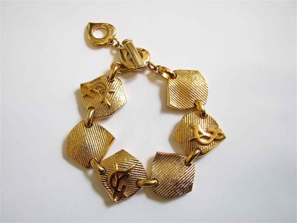 Yves saint laurent 39 ysl 39 gilt earrings and bracelet at 1stdibs - Bracelet yves saint laurent ...