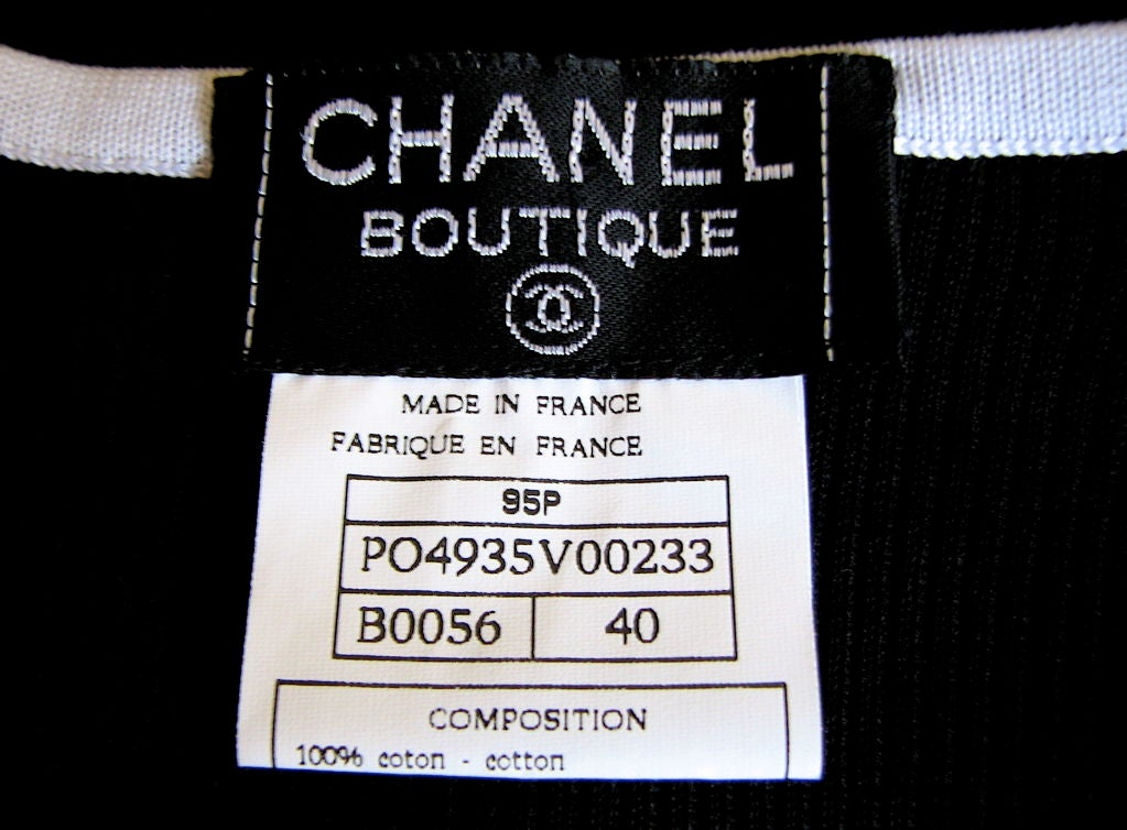 CHANEL cropped black cardigan with CC buttons 4