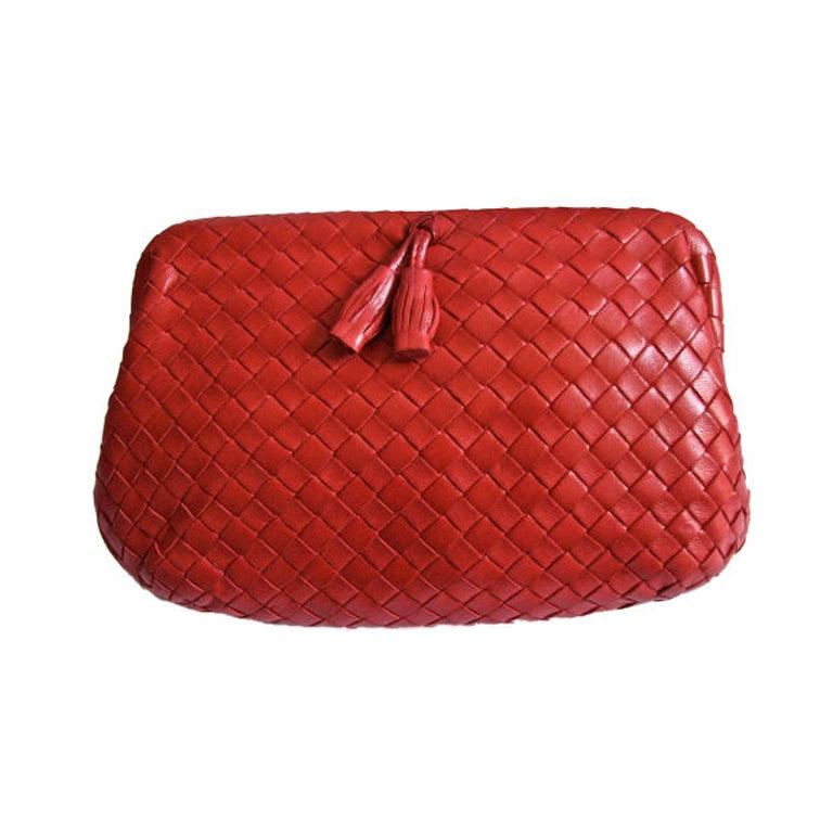 BOTTEGA VENETA red woven leather clutch with tassels 1