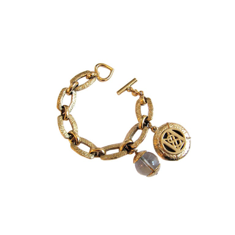 Yves saint laurent gold bracelet with ysl and rock quartz charms at 1stdibs - Bracelet yves saint laurent ...