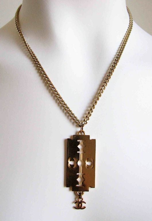 Chanel gold razor blade necklace with cc charm at 1stdibs chanel gold razor blade necklace with cc charm for sale 2 altavistaventures Images