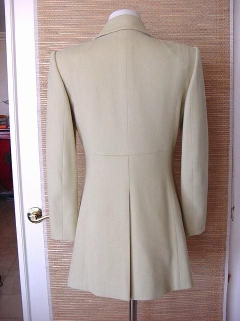 Utterly chic and sophisticated in a VERY pale celadon green. 4 on 4 Double breast jacket in heavenly soft cashmere. 2 'slit' pockets in front just above the waist line. 2 Angled zipper pockets. Toggles are signature leather with white top stitch