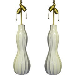 Pair of elegant white  glazed  vessels with lamps application.
