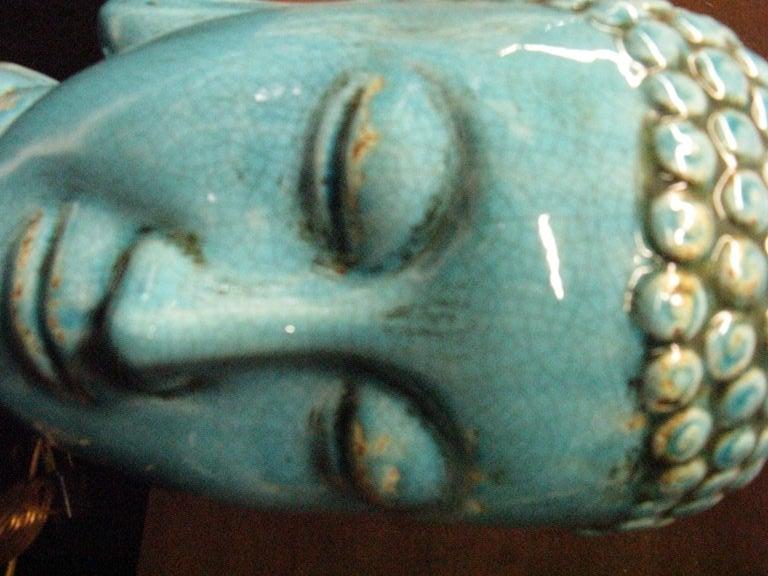 Pair  of glazed ceramic  buddha heads . 1