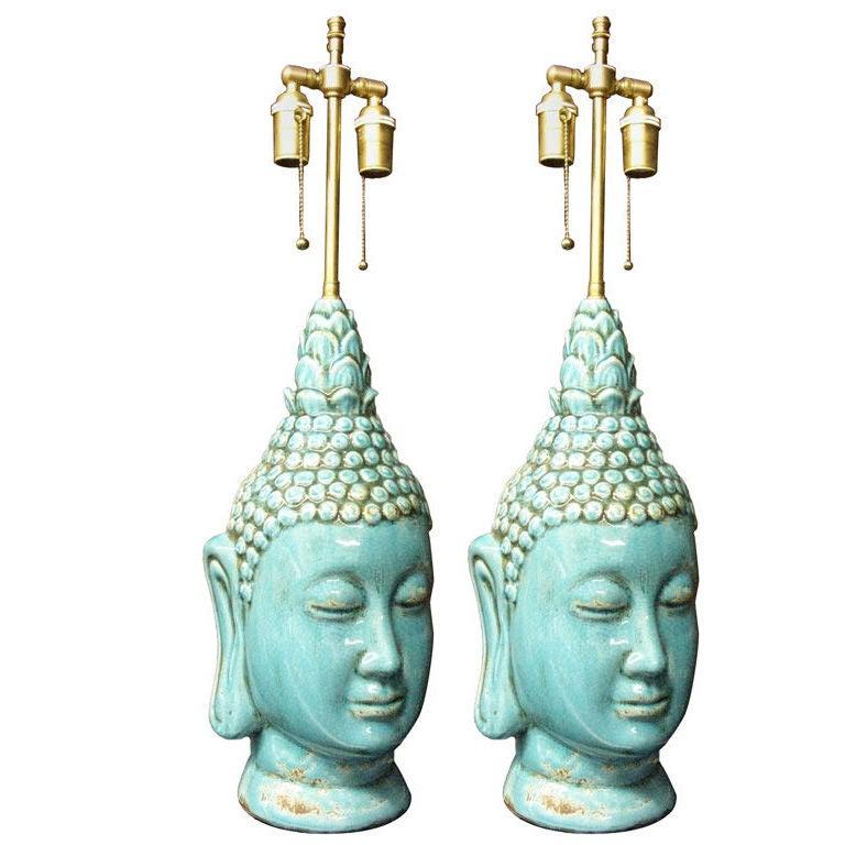 Pair  of glazed ceramic  buddha heads .