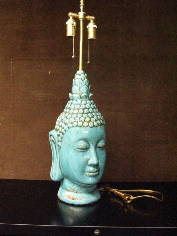 French Pair  of glazed ceramic  buddha heads .