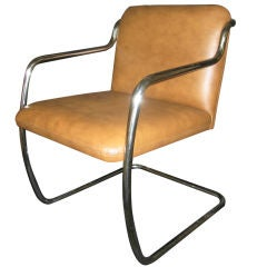 4 Stainless Steel framed armchairs by Brueton.