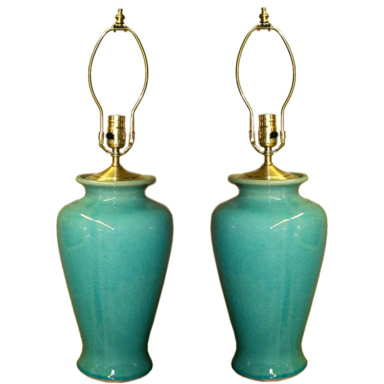 pair of celadon style glazed ceramic table lamps in turquoise at