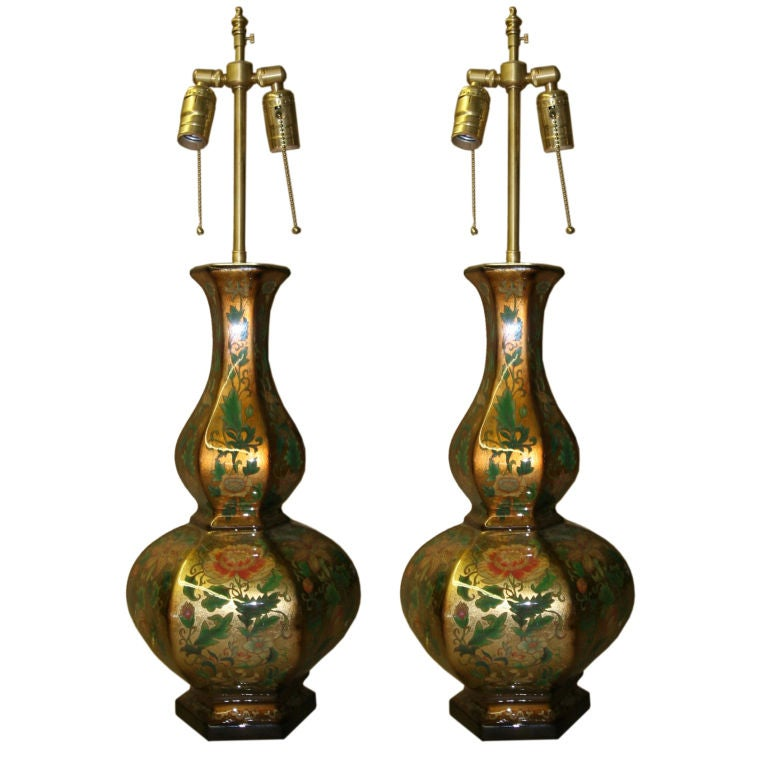 Pair of Eglomise vases with lamp application.