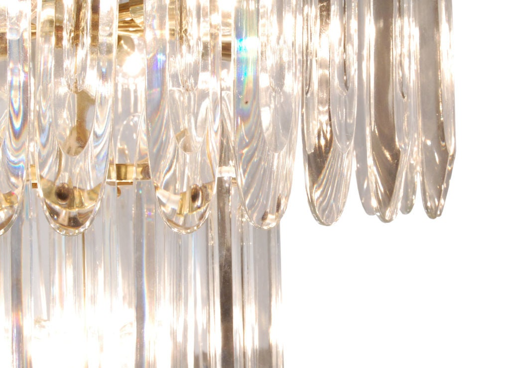 Chandelier with large crystals by Sciolari, Italy 1950s. This chandelier has 12 bulbs. The height on this listing is for the chandelier only (does not include the chain).
