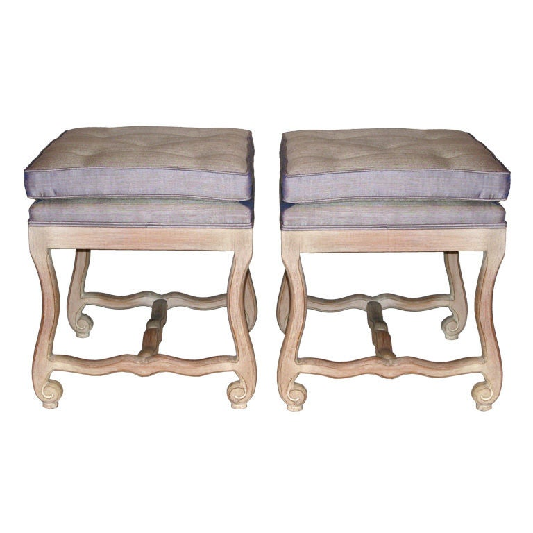 Pair of hand carved benches with upholstered seats at stdibs