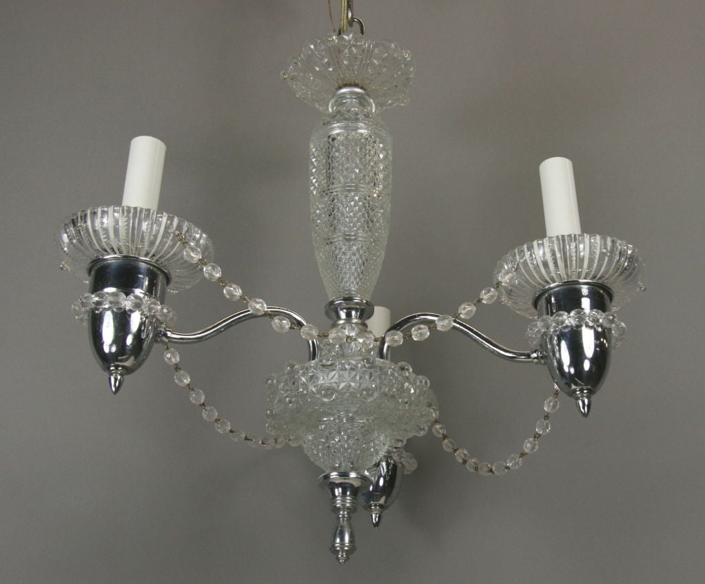 #1-2545. A three-light nickel and glass beaded chandelier.