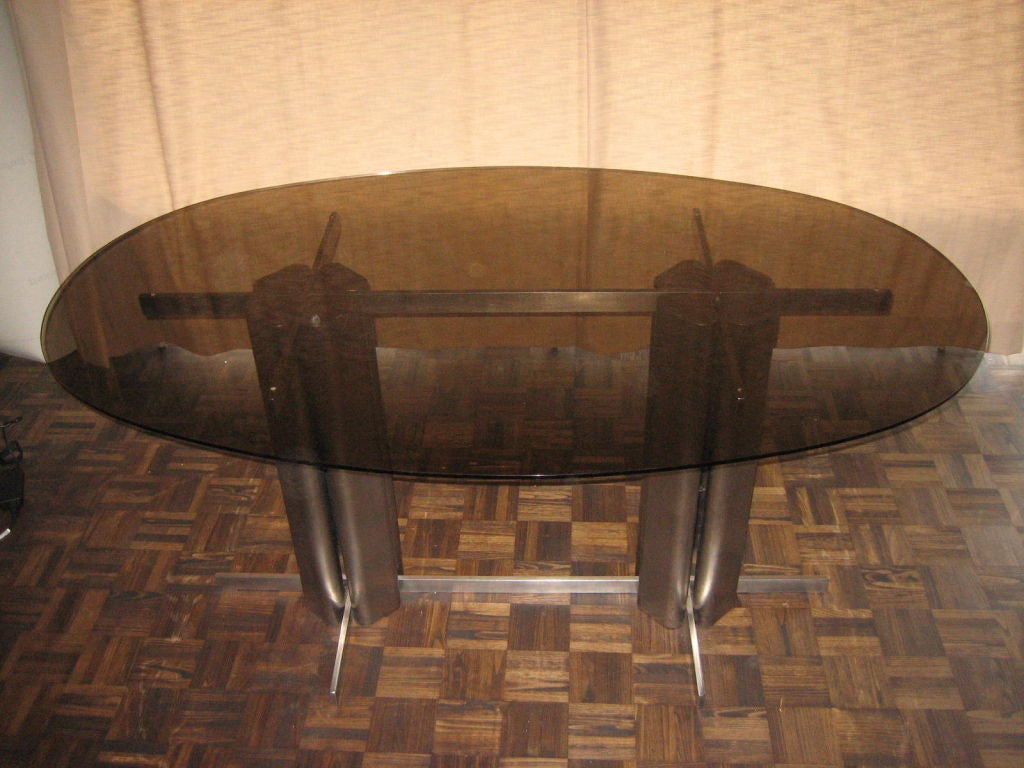 Oval St Gobain glass dining table. Located in France.