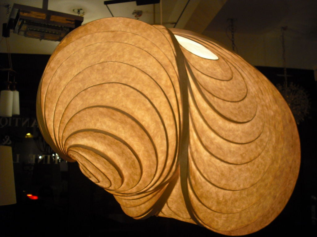 """A large beautiful paper mache lantern by artist, Stephen White. The title of the work is """"Cetaceous"""" .The light has a great warm aged patina. Four light sources.Rewired. Signed"""