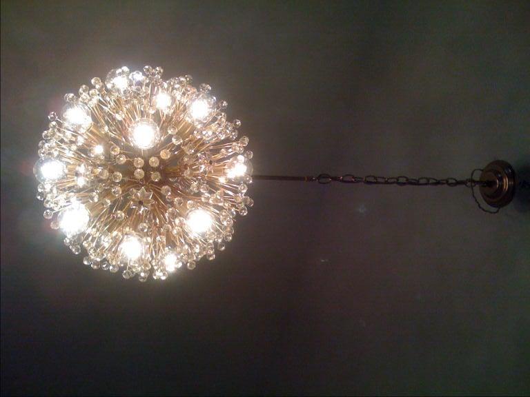 A wonderful brass and crystal Austrian chandelier by JL Lobmeyr.