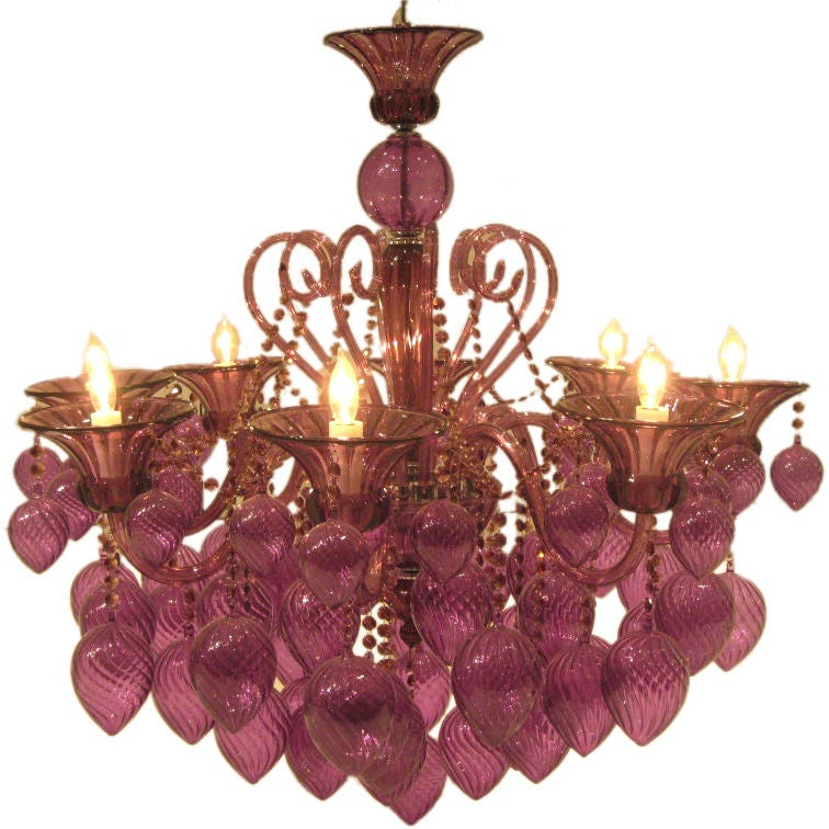 Two contemporary handblown eight-light Venetian glass chandeliers in purple glass featuring glass decorations in a crossbanded tear drop form.