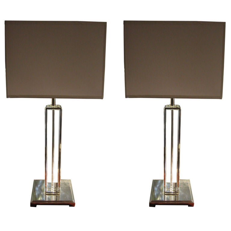 Elegant pair of Italian midcentury style solid crystal table lamps in a modern neoclassical column-form with silver plated base and column detailing.  UL wired for 150 watts. Square hardback silk shades.