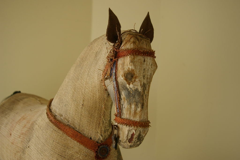Beautifully distressed horse on red aged patina wood frame rocker.