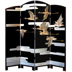 A Chic American Art Deco Lacquered Screen Depicting a Soaring Flock of Birds