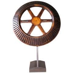 A Massive American Oak Industrial Gear Wheel Raised on Stand