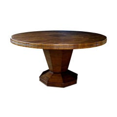 A Boldly-Scaled American Walnut Circular Center/Dining Table