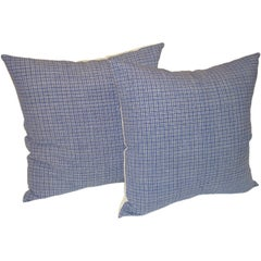 19TH C. LINEN PLAID PILLOWS IN BLUE AND WHITE.