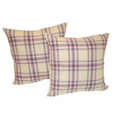 19TH C. LINEN PLAID PILLOWS IN RED, WHITE AND BLUE.
