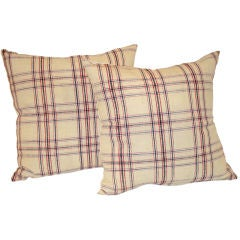 19TH C. LINEN PLAID PILLOWS IN  RED, WHITE, AND BLUE.