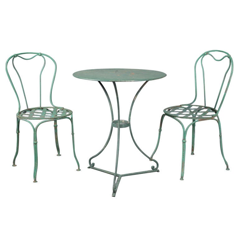 French 1920s wrought iron bistro table and chairs at 1stdibs for Wrought iron cafe chairs
