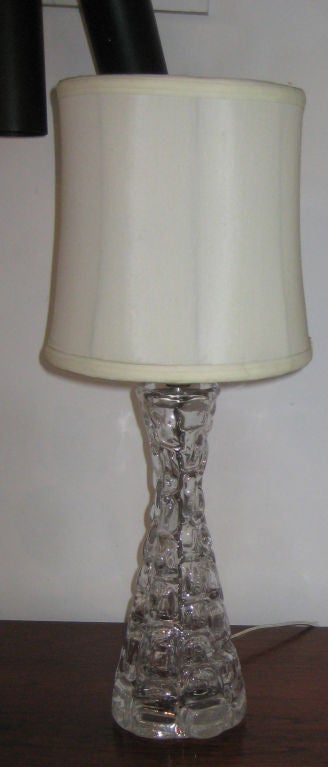 "Clear crystal lamps in molded honeycomb hourglass design. Signed ""Carl Fagerlund Orrefors"" on the underside."