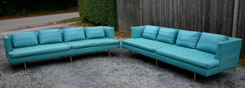 Exquisite pair Edward Wormley for Dunbar long and deep 4097A sofas in original upholstery; with solid brass legs; down-filled pillows; button cushions; original owner.