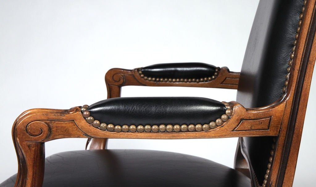 Pair Of Black Leatherette And Walnut Fauteuils By Chateau