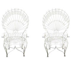 Two  Early Decorative Iron Chairs