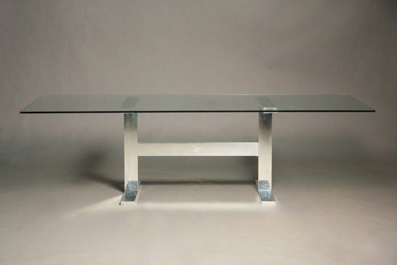 solid polished aluminum dining table with large glass top