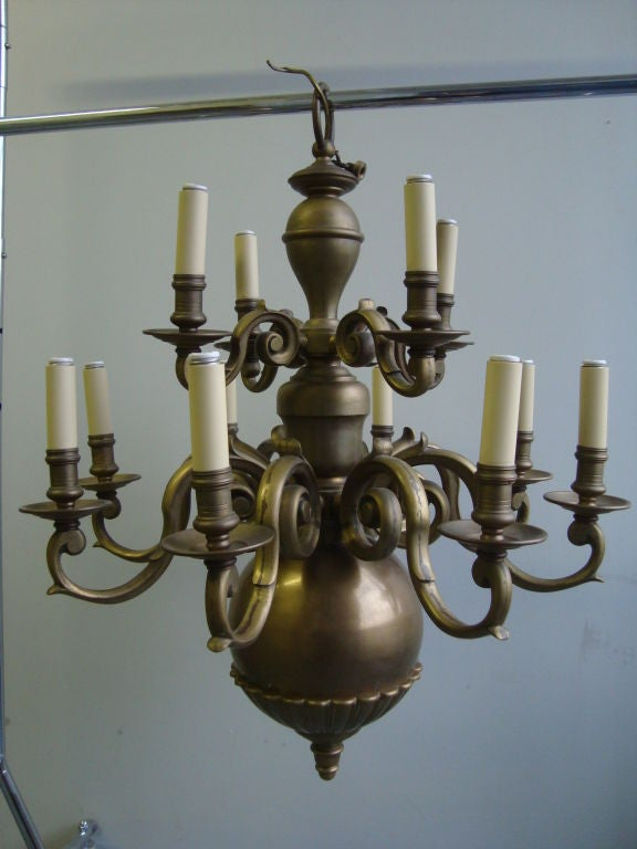 A Brass Twelve Light Chandelier  2