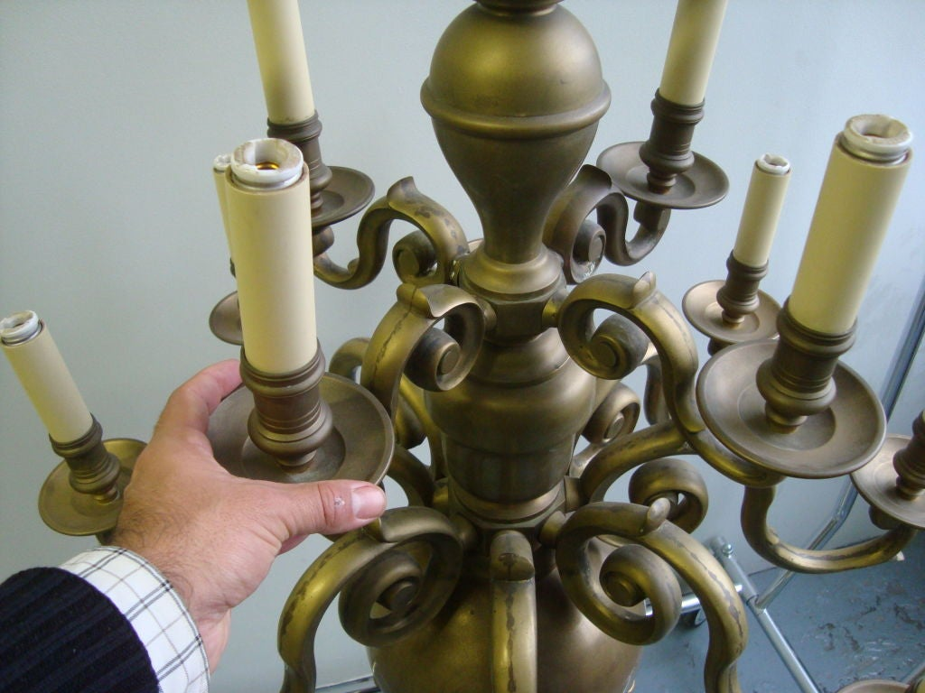 A Brass Twelve Light Chandelier  10
