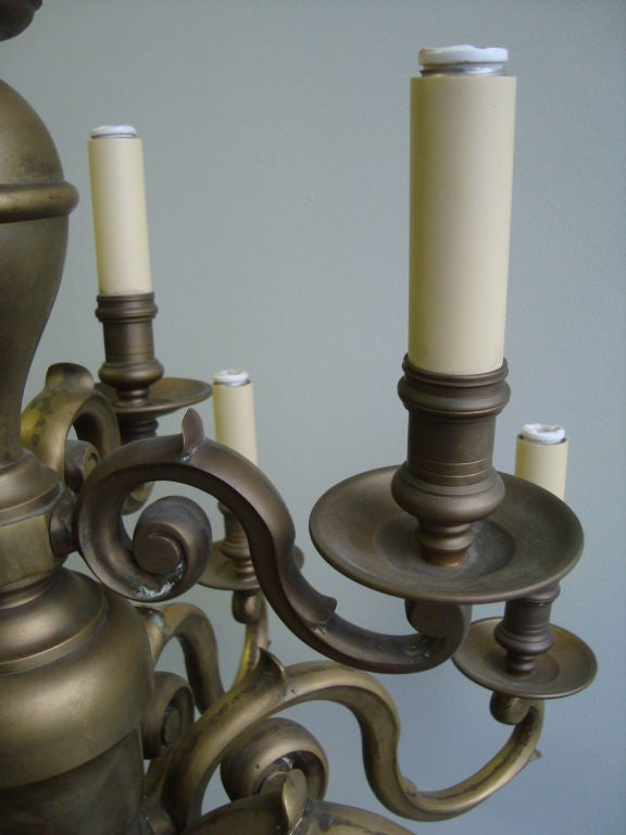 A Brass Twelve Light Chandelier  3