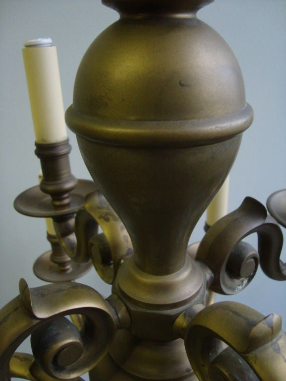 A Brass Twelve Light Chandelier  5
