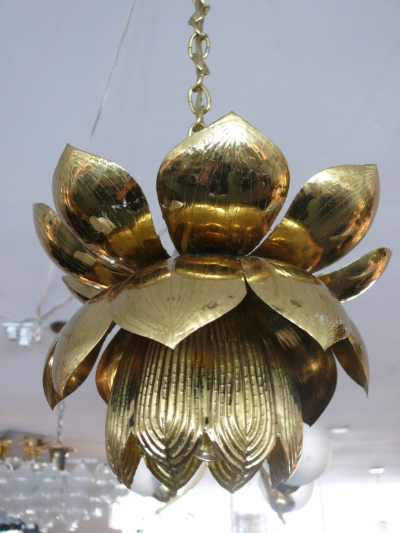 Sculptural brass chandelier in the shape of a lotus flower. Beautiful patina to the brass.<br />