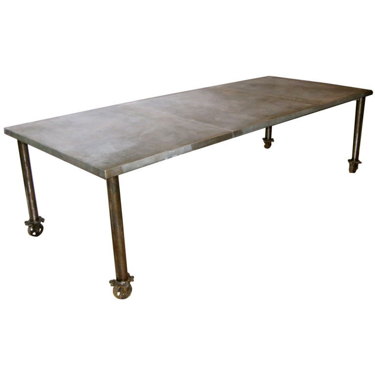 Industrial zinc top dining table on wheels at 1stdibs for Table exterieur zinc