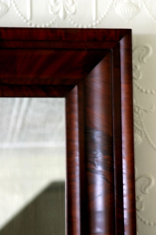 Mahogany and mahogany veneer ogee mirror in original condition.