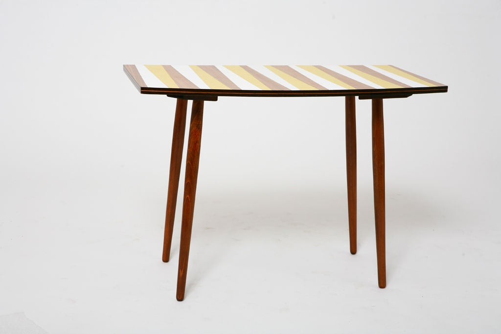 beech and stained oak construction; light shellac finish; laminate top